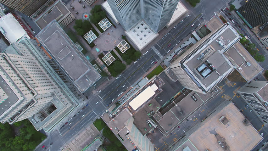 Montreal Quebec Aerial v73 Flying low over downtown buildings looking down vertically