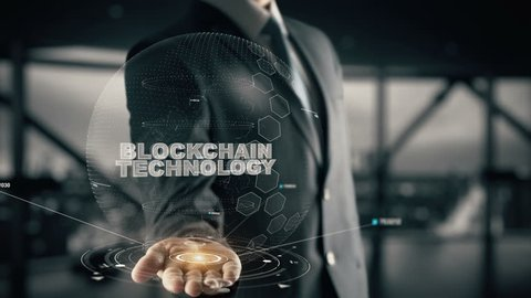 Blockchain Technology with hologram businessman concept