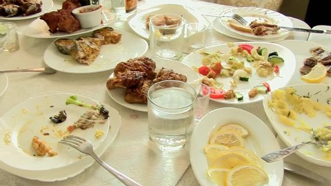 Wasted food on festive table after dinner party