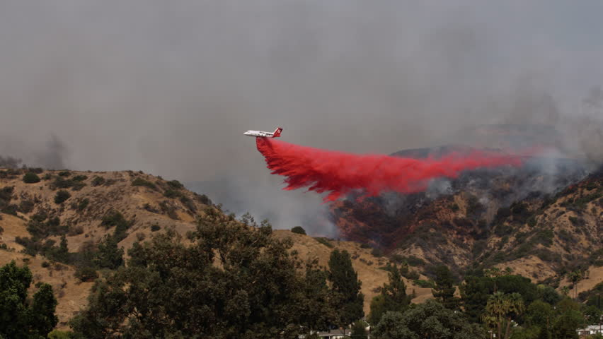 Airplane Drops Fire Retardant on Wildfire