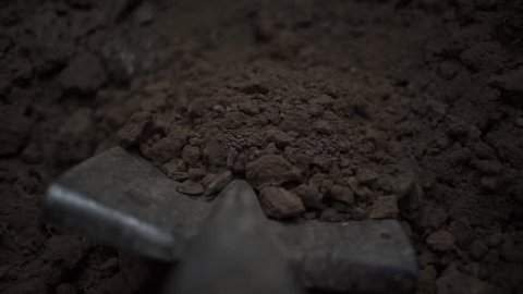 To dig in the Shovel. Footage. Soil with shovel view of a shovel. Close-up, shallow DOF. Digging spring soil with shovel