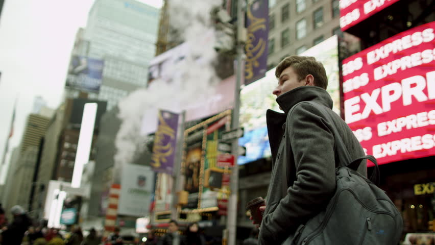 Young tourist walking on Times Square with a cup of coffee | Shutterstock HD Video #30436477