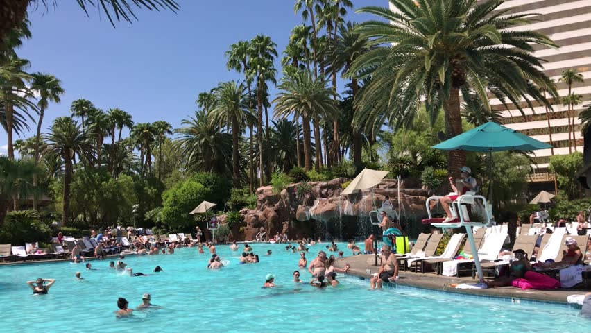 Las vegas april 18 tourists relax by the pool of luxor - Luxor hotel las vegas swimming pool ...