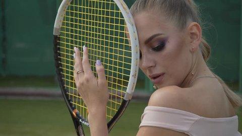 Sexy tennis girl posing at the camera