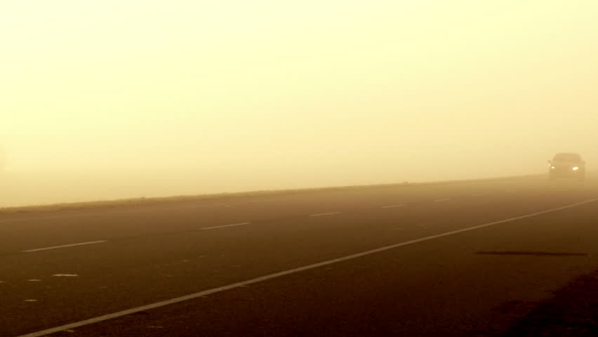 Cars passing over a foggy route. 3 shots | Shutterstock HD Video #3044527