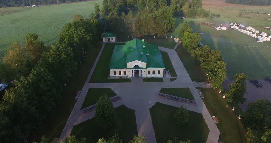 4K aerial video footage of old beautiful 1812 war historical military museum erected in 1912, road and fields area around it near Borodino 120 km west of Moscow, capital of Russia on summer morning