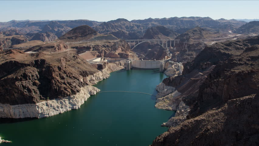 Aerial view Hoover Dam on US 93 tourist destination with Colorado River Bypass bridge and Lake Mead Nevada Arizona America RED WEAPON