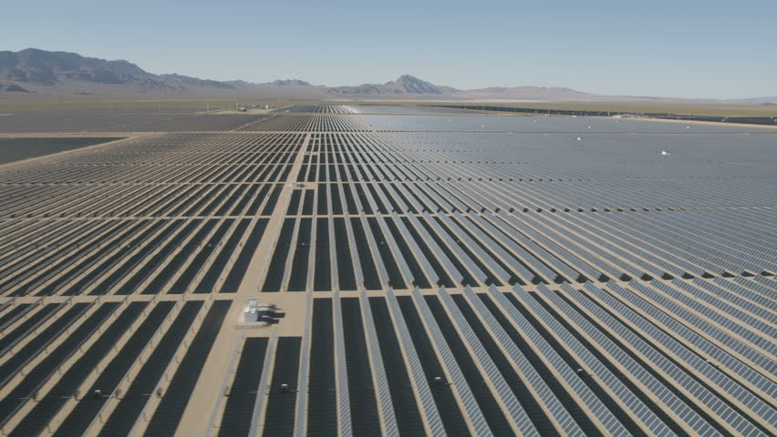 Aerial desert view Photovoltaic solar panels harvesting clean energy from the sun natural alternative power Las Vegas Nevada USA RED WEAPON | Shutterstock HD Video #30458347