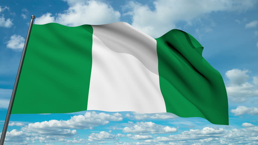 nigeria flag waving against time-lapse clouds background stock