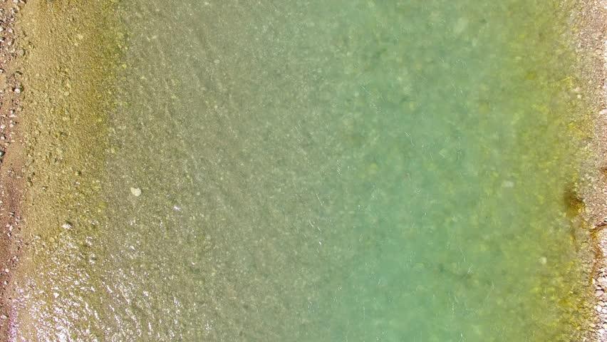 Camera flight over The Isar River that flows to Sylvenstein Lake in Bavarian Alps near Garmisch Partenkirchen. Germany, Central Europe.