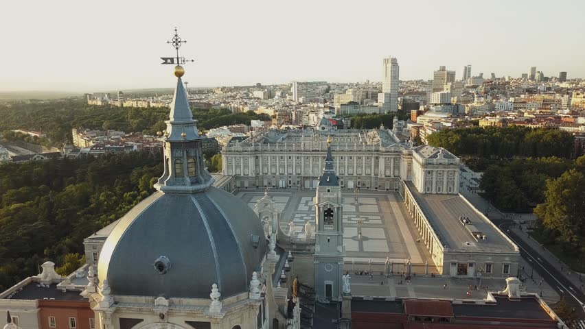 flying drones over the royal palace in Madrid Spain and the circus before sunset