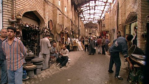BAGHDAD, IRAQ - CIRCA 2002: Baghdad before the 2003 Gulf War. A busy scene in the traditional covered market or souq Al Safafir, showing stalls, vendors, shoppers and tradesmen.