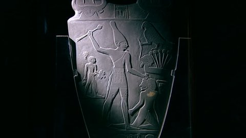 CAIRO, EGYPT - CIRCA 2002: Dramatic raking light highlighting King Narmer wearing the White Crown of upper Egypt, wielding a mace in readiness to bludgeon an enemy. Narmer Palette, Museum of Cairo.