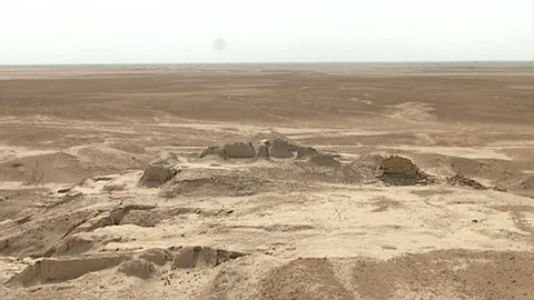 WARKA, IRAQ - CIRCA 2002: WIDE SHOT from the top of the White Temple ruins (originally built atop Anu Ziggurat) as part of the Anu district of Uruk. Stone Temple remains in the background.