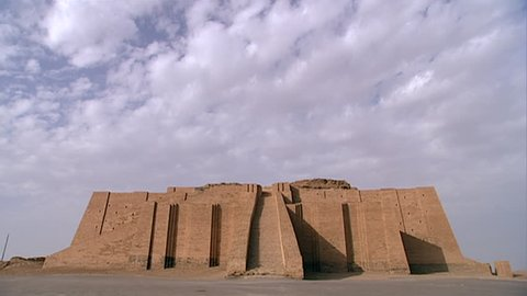 TELL EL-MUQAYYAR, IRAQ - CIRCA 2002: Archaeologist walking towards the Great Ziggurat of Ur. Built in the Early Bronze age by King Ur-Nammu as part of a temple complex dedicated to moon god Nanna.