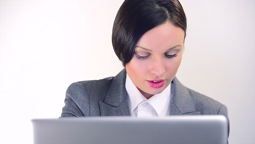 Businesswoman working with laptop and papers, then she is celebrating success, thumbs up and showing blank business card. Focus moves to card.