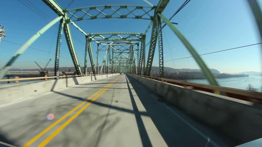 Perspective view of driving over the Ambridge Bridge between construction