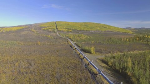 Aerial footage of the Alaska oil pipeline in the fall season, Dalton Highway