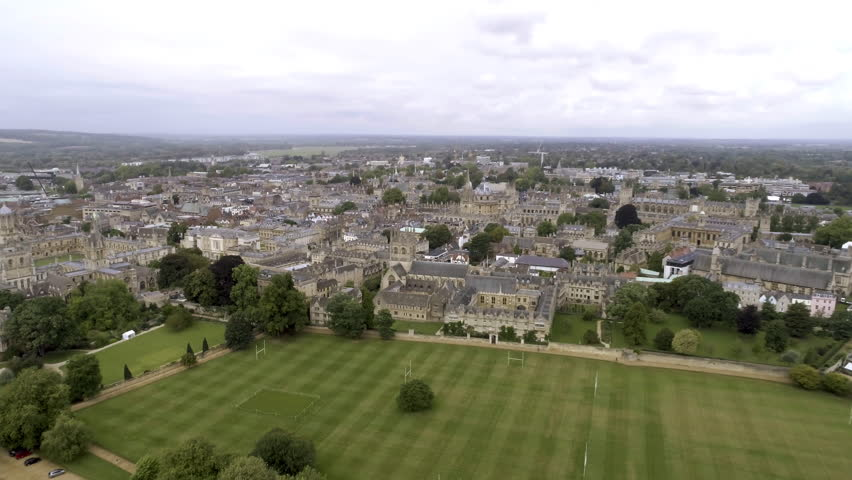 Aerial View University of Oxford Iconic Education Landmark feat. College and Campus. Flying Over around Prestigious Collegiate Research University Located in Oxford, England United Kingdom 4K
