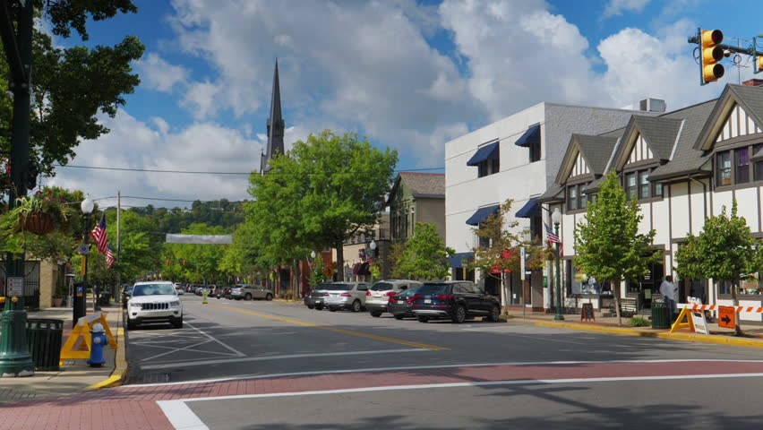 A daytime establishing shot of an intersection in the business district in the upscale small town of Sewickley, about 15 miles north of Pittsburgh.