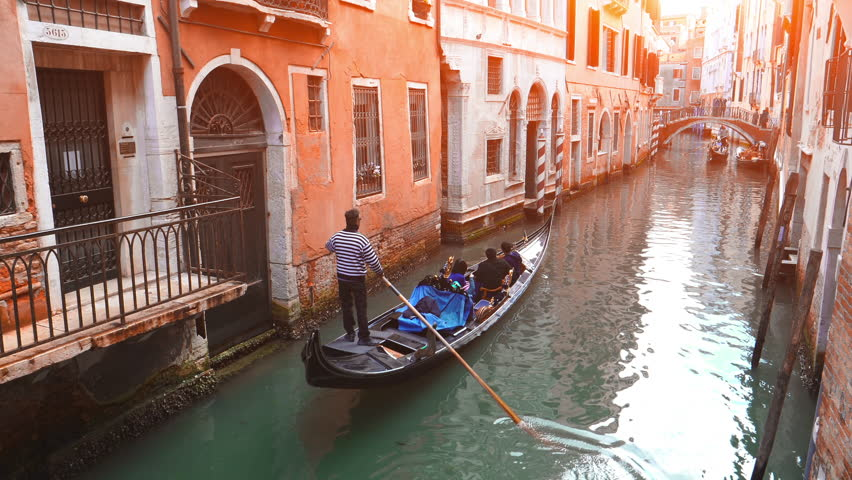 Tour in gondola, rowed by a gondolier in Venice canal, Italy | Shutterstock HD Video #30591007