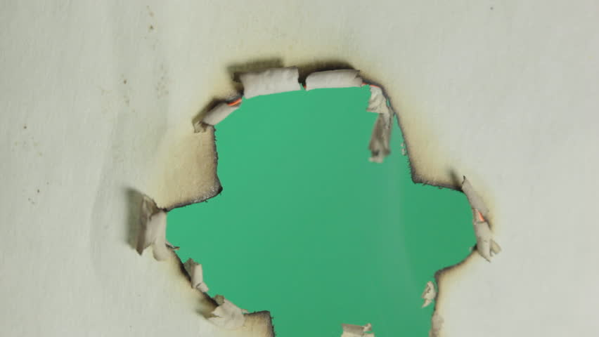 Burning paper. Macro. Green screen.