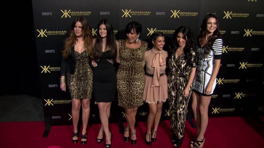 Hollywood, CA - AUGUST 17, 2011: Khloe, Kourtney and Kim Kardashian with Kendall, Kris and Kylie Jenner, walk the red carpet at the Kardashian Kollection Launch Party held at the The Colony