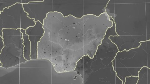 The Nigeria area map in the Azimuthal Equidistant projection. Layers of main cities, capital, administrative borders and graticule. Elevation & bathymetry - grayscale