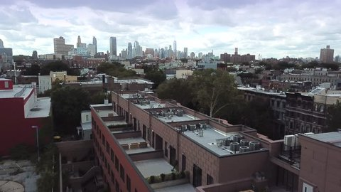 Brooklyn, Clouds NYC AERIAL with Manhattan Skyline, 2017, Bedford-Stuyvesant area. Could be darkened for mood..