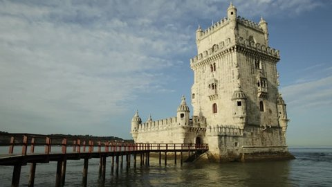 Belem Tower in low tide in the morning. Torre de Belem is Unesco Heritage and symbol of Lisbon, in Belem District on Tagus River. Belem Tower is the most visited tourist attraction in Lisbon, Portugal