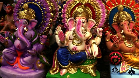 Three Ganesha sitting beside each other, its very lucky to keep three Ganesha with you  shot in 4 K edited with different color filters.