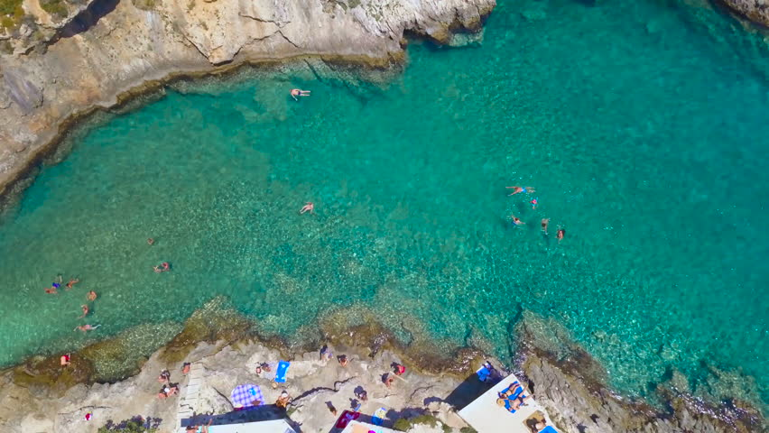 Aerial footage of people swimming, snorkeling, sunbathing at Porto Limnionas beach, Zakynthos Greece | Shutterstock HD Video #30750547