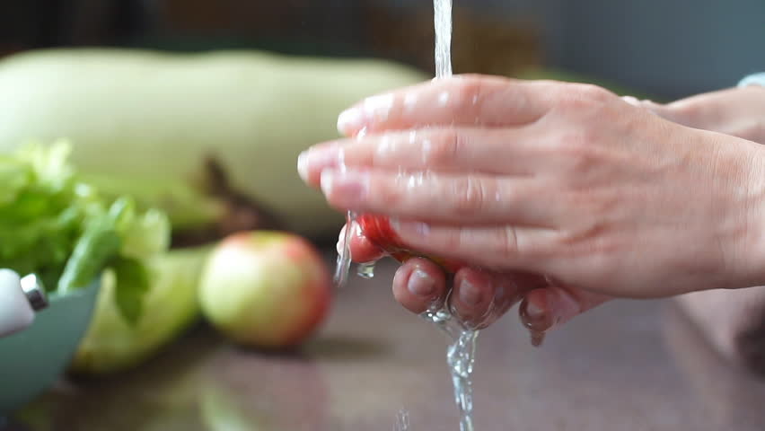 Young Vegan Girl Washing Red Apples. Hand Holding Fresh Fruits Under Running Water in Kitchen Sink. Healthy Lifestyle Hygiene Concept.
