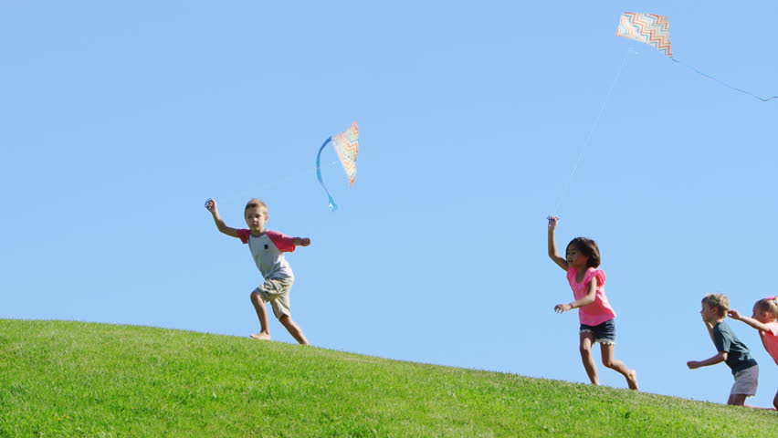 Group of Children Flying Kites. Video de stock (totalmente libre ...