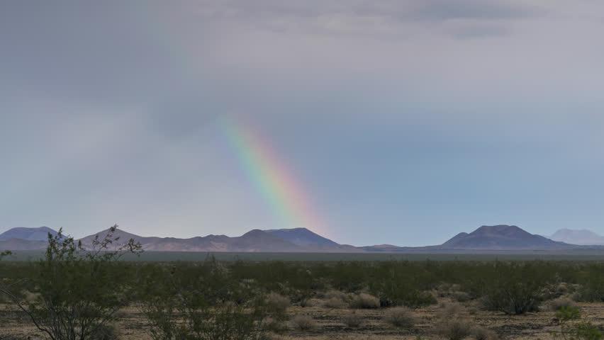 Rainbow in Thunderstorm Mojave Desert 4K from 6K source | Shutterstock HD Video #30764302