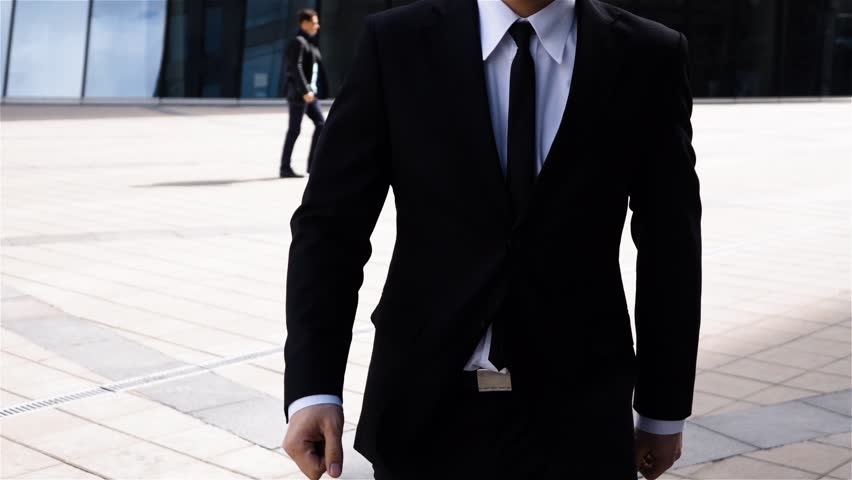Epic portrait of successful attractive businessman outdoor near business centre. He in formal suit. Looked very sure in himself, assertive. Super slow motion shot.  | Shutterstock HD Video #30804097