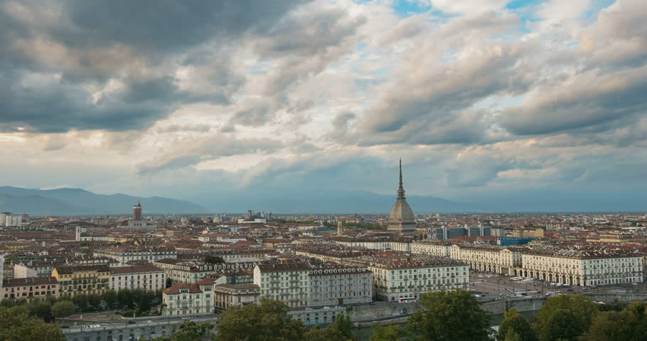 Turin time lapse, Torino skyline, Italy. Day to night time lapse. Mole Antonelliana towering over the buildings. Dramatic sky on the Alps, city lights at twilight. Travel destination, historical town. | Shutterstock HD Video #30852697