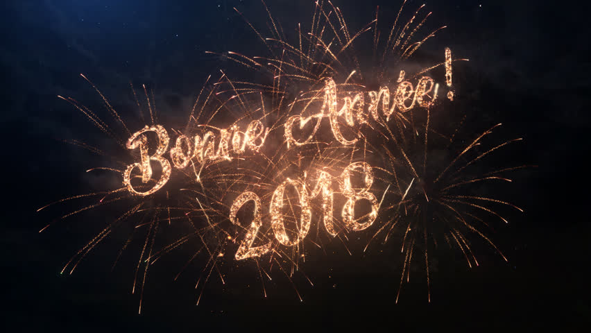 2018 Happy New Year greeting text in French with particles and sparks on black night sky with colored slow motion fireworks on background, beautiful typography magic design. | Shutterstock HD Video #30877360