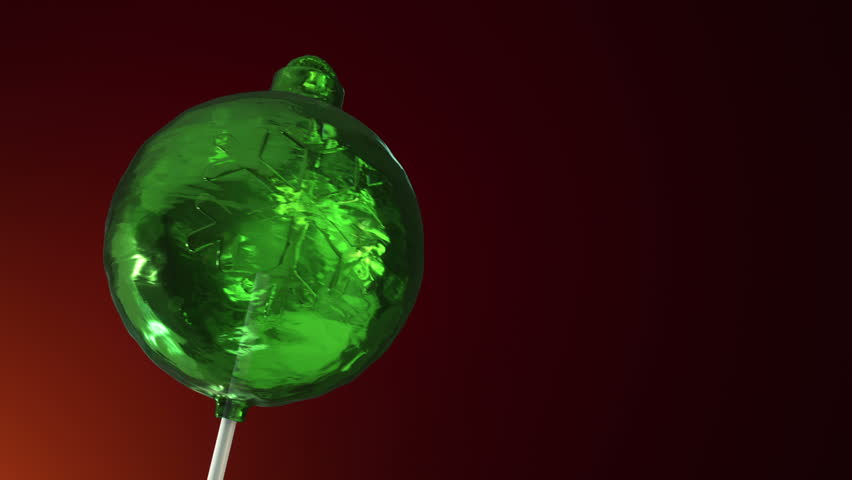Animation of rotation lollipop candy on plastic stick as form of christmas ball for christmas tree on colorful background. Animation of seamless loop. | Shutterstock HD Video #30894247