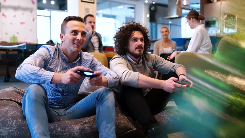 Two coworkers playing games in startup office | Shutterstock HD Video #30898027