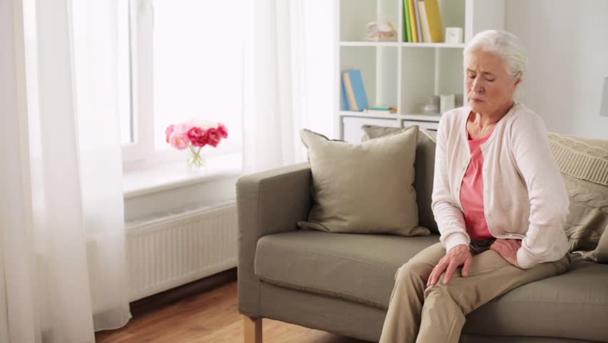 Old Age Health Problem And People Concept Senior Woman Suffering From Pain In Leg