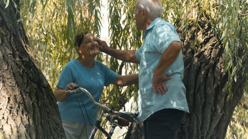 Old man and woman talks under willow | Shutterstock HD Video #30918607
