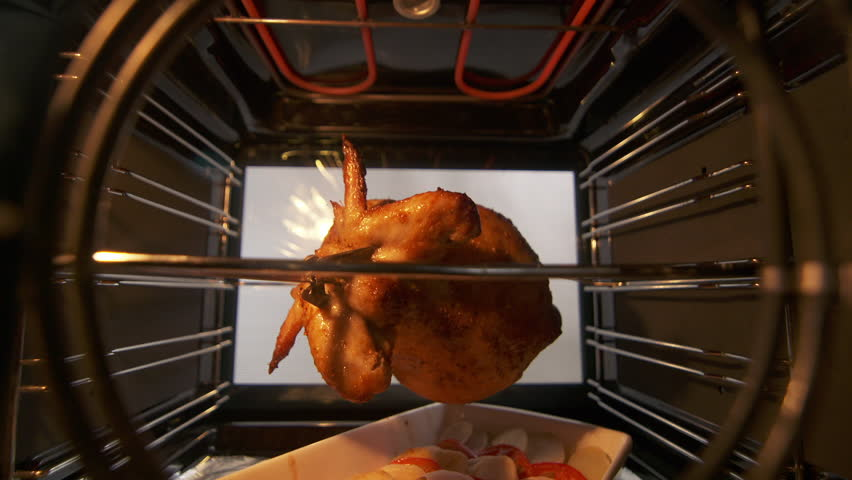 Cooking Roasted Whole En On The Rotisserie Spit In Hot Convection Oven Hd Stock Fooe