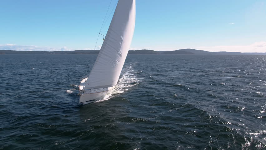 Aerial - Sailboat sailing in highwinds in British Columbia | Shutterstock HD Video #30948037