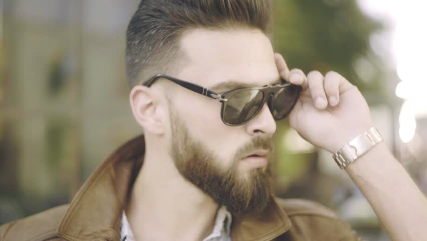 Bearded man portrait. Stylish hipster man face. Guy bearded in sunglasses. Close up of handsome bearded man sunglasses