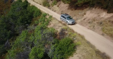 Aerial drone over subaru forester on dirt. Figueroa Mountain. Santa Barbara, California.