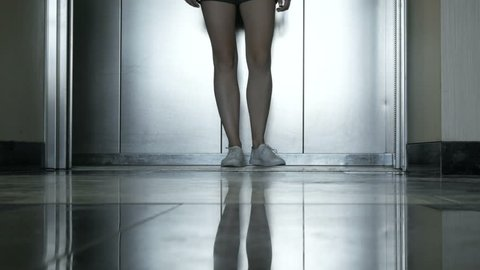 Low section legs woman coming in and out from the elevator
