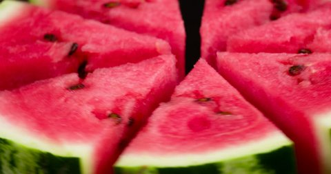 Plate with Slices of Watermelon. Video Loops. Triangular slices of watermelon rotate in front of the camera
