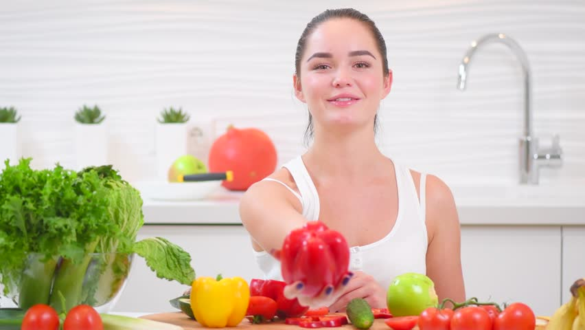 Beauty Joyful Girl Holding Fresh Vegetables And Smiling In Her Kitchen At Home Healthy Eating