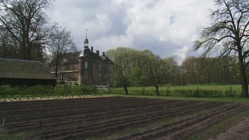 VORDEN, THE NETHERLANDS - APRIL 2012: Hackfort estate + pan surrounding landscape and historical kitchen-garden. Hackfort Caslte dates from the 14th century  (1376)